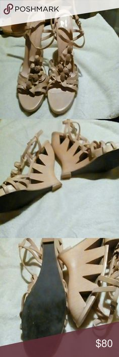 DONALD PLINER.  5 inch wedges barely worn Tan leather wedges with cutouts in the heel. Ankle straps, leather flowers on the front with 4 straps covering toes. Donald J. Pliner Shoes