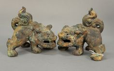 Pair of Chinese iron foo dogs with remnants of paint.  ht. 6 1/4 in.; lg. 6 1/2 in.  Provenance:  The Estate of Natalie Rafferty  Estimate: $100 - $300