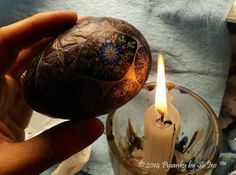 Removing the wax with a candle flame Ukrainian Easter Egg Batik Art Pysanky By So Jeo