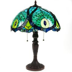 Bright blues, teals and greens create a peacock-inspired design in this stained glass Tiffany style lamp.
