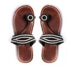 "Rafiki (Ra-fee-key), our popular sandal means ""friend"" in Swahili. This style will become just that as it offers two straps for added comfort and support. These handcrafted beaded leather sandals are ethically made in Kenya. Fit It is okay if they feel snug at first, as the leather will soften and stretch within the first few weeks"