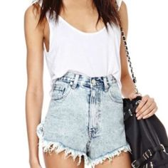 """#139 These cutoff shorts will get you through wild nights and late mornings! They features an acid wash, a high-waist, and a zip/button closure at front. Classic 5-pocket style. Pair them with a white tee and a moto jacket--the perfect look for just about any occasion. By UNIF.  *100% Cotton  *27.5""""/70cm waist  *15""""/38cm length  *2.5""""/6.5cm inseam  *13""""/33cm rise  *Model is wearing size small  *Measurements taken from size small  *Machine wash cold  *Imported UNIF Shorts"""