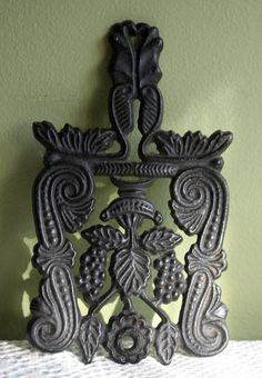 Vintage Trivet.  Cast Iron Trivet with  Grapevine Pattern.  Vintage Functional Trivet or Rustic Home Wall Hanging Decor. Marked T-4 Grape. by AnythingDiscovered on Etsy