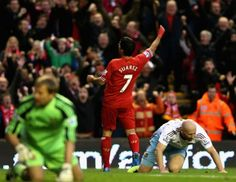 Luis Suarez celebrates the opening goal