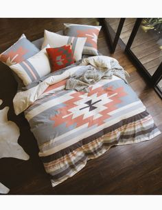 Inspired by Navajo textile heritage, this duvet cover set features traditional motifs that are combined with a rich palette of terracotta, charcoal greys and tawny creams to create a unique stonewashed stripe.