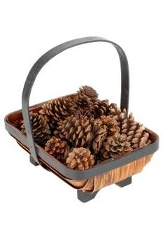 basket of pine cones by fireplace