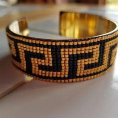 Bracelet manchette noir et doré