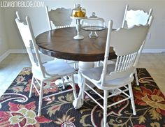 paint old wood chairs white, bottom of table white, and stain top of table.  Put rug underneath
