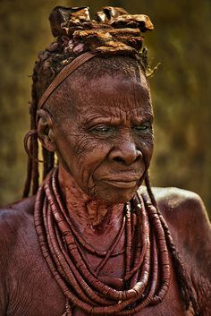 Himba Tribe Elder Wearing Necklaces, in a Himba village about 15 km north of Opuwo, Namibia, South Africa | Photo by Paul W Sharpe Aka Wizard of Wonders with Pin-It-Button on FineArtAmerica