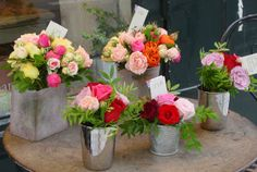 Parisian flower arrangements in small metal tins