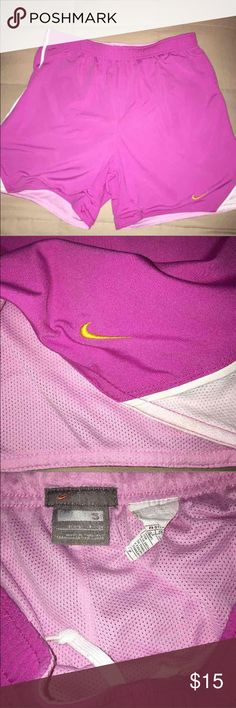 """Nike Mesh lined Running Short Small Women's Purple Nike Mesh lined Running Shorts Small wms Measures approx 3"""" inseam, 10"""" rise, 13"""" waist laying flat Medium purple and white with pink mesh Nike Shorts"""