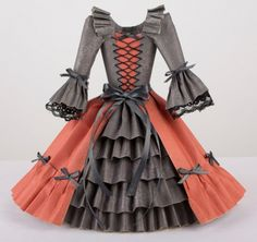 Checkout these amazing paper dresses by Tara at Pion Designs. Tara really is the queen of paper crafting! She is a very talented paper artist and I highly recommend stopping by for a visit. You are sure to be inspired by her designs. #WeeklyScrapper