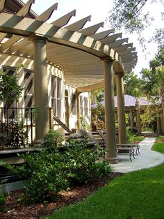 Curvelicious attached pergola design. Sweeping dramatic effect!