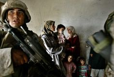 US Marines of the 1st Division raid the house of a city council chairman in the Abu Ghraib district of Baghdad, Iraq, Nov. 2, 2004.