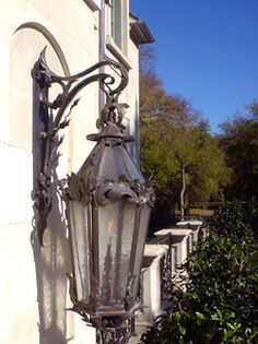 Wrought iron lantern with unusual embellishments