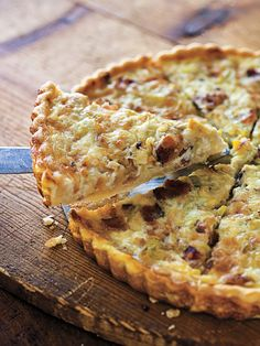 Bacon and Leek Quiche- Single-crust flaky pastry dough 4 thick slices Applewood-smoked bacon, coarsely chopped 1 Tbs. unsalted butter 2 small leeks, white and pale green parts, chopped 1 cup half-and-half 2 large eggs 1/2 tsp. kosher salt 1/4 tsp. freshly ground pepper 1/8 tsp. freshly grated nutmeg 1 cup shredded Gruyère cheese