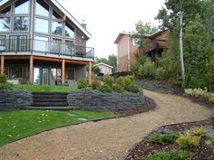 Lakeside Cottages and Country Homes by Creative Landscape & Design. Rock Wall and Stone Garden Stairs