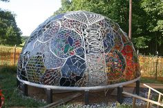 Artist Carol Geary, aka Caroling, conceived, built, and completed this incredible stained glass dome, entitled Wholeo Dome. Guests can enter the sculpture and surround themselves with the vibrations of colorful light that stream in through the stained glass