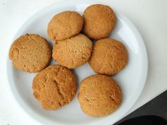 Ingredients: (for about 7 cookies)  - 1/2 cup peanut butter  - 1/4 cup vanilla whey protein powder  - 3 small egg whites (or 2 large egg whites)  - 1 tsp baking powder