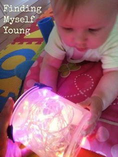 Fun light play for babies. Really easy and cheap activity to keep them entertained for ages. Great sensory play too. Baby Room Activities, Infant Sensory Activities, Baby Sensory Play, Baby Play, Activities For Kids, Baby Toys, Baby Sensory Lights, Baby Christmas Activities, Sensory Play For Babies