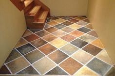 """Photo: simplystonehaven.blogspot.ca If you're unhappy with an unsightly concrete floor, paint it! Faux finished to look like multi-hued tile, this floor was meticulously taped, painted, then """"grouted with white paint."""