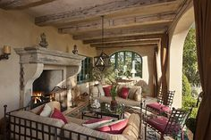 Great porch...love outdoor fireplaces!