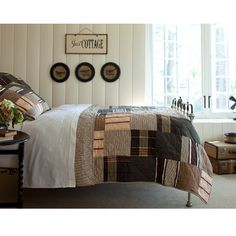 This brand new patchwork quilt is a handsome blend of plaids, stripes, and tweeds. It is masculine, classic, and cozy. Pair with our Homespun Accent Collection. 100% Cotton.  Machine Washable. 85