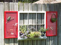 Repurpose an old window and shutters to dress the fence.