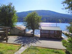 LOWEST PRICED RESIDENTIAL WATERFRONT ON THE LAKE! Here you'll find a boat house, dock, and dockside patio just steps from the front door of this cozy waterfront home with a wood burning fireplace. Relax and enjoy the gorgeous water and mountain views from the deck. Level frontage to a sandy bottom makes a great place to take a dip in the lake. Includes a bunk house that sleeps 4. Bathroom has been completely remodeled and new water filtration system has been installed.