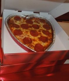 If you're making her favourite pizza on Valentines Day, why not shape the base in a heart shape before adding the toppings. These little details will be super cute. xx Sorry, no link.