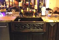 A open scroll inlay is placed behind a beautiful brown scroll cutout on the flat apron front of this 33 inch copper farmhouse sink in scroll design copper kitchen sinks. Copper Farmhouse Sinks, Copper Kitchen, Kitchen Sink, New Kitchen, Scroll Design, Solid Wood Furniture, Rustic Interiors, Kitchen Hacks, Rustic Kitchens