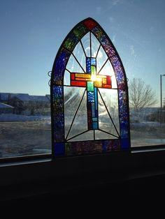 Morning sun through the cross