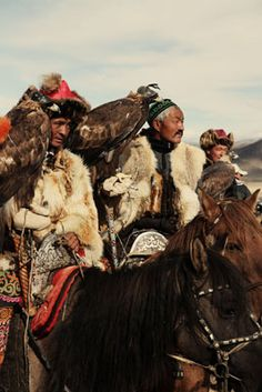 Hunters on horses with wings  In the Western Altai mountains, in Mongolia these hunters live with their families and their golden eagles, in gers  The golden eagle such a beauty, and powerful animal, which helps the Kazahks hunt