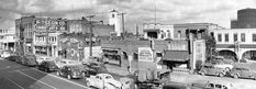 A file photo from 1948 of an entire block along North Los Angeles Street, the last vestige of old Chinatown. The area was razed to make way for a freeway and parking area. The historic Lugo House, a white-gabled building, is at the extreme left. (Los Angeles Times)