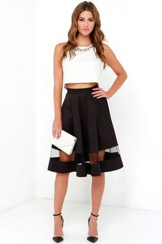 Take charge of your look, and make an entrance with the Sheer and Now Black Mesh Midi Skirt! Black silky woven fabric is formed into a high waistband atop vertical seaming and a flattering A-line silhouette. A band of sheer mesh creates a stylish peekaboo effect above the midi-length hem. Hidden back zipper with clasp.