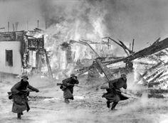 Germans attacking through a burning Norwegian village 1940