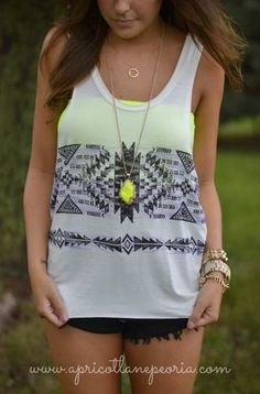 i like the shirt but the necklace is cool