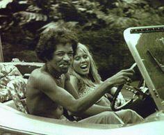 Jimi Hendrix driving a beach buggy : Jimi Hendrix smoking a cigarette and driving a beach buggy with a nice blonde girl.    Jimi Hendrix fumava um cigarro e dirigir um buggy de praia com uma menina loira agradável. | tomtom122