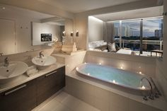 WOW.. what more needs to be said...Master Bath w/ Glass Opening - modern - bathroom - miami - RS3 Innovative + Architectural DESIGN