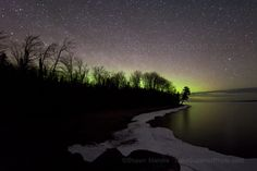 the white pine sillouetted in this picture by the northern lights at the point by autrain boat launch has lost it's battle to erosion and gravity- prob fell some time within the last month        for more northern lights photos or to purchase prints, visit: http://lakesuperiorphoto.photoshelter.com/gallery/Northern-Lights-Upper-Michigan-Aurora-over-the-Upper-Peninsula-of-Michigan-Lake-Superior/G0000o7ySHutM5BQ/