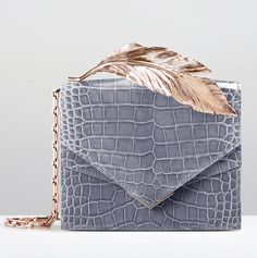 Crafted in France, the Alina clutch is created with the finest hand-selected Alligator Mississippiensis skin; renowned for its durability and flawlessly symmetrical scales.