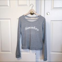 Urban Outfitters Gray Sweater Perfect like new condition. Worn once or twice. Soft heather gray material. Intentionally distressed text - somewhere Urban Outfitters Sweaters Crew & Scoop Necks