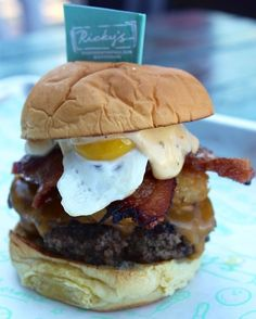 Burgers for breakfast: bacon, smashed tater tots, truffle honey, aioli, cheddar cheese, and a fried quail egg
