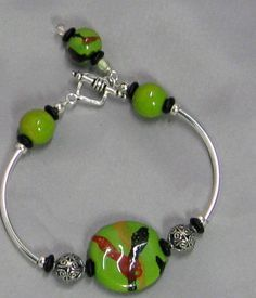 Apple Green African Kazuri Bracelet More necklaces and bracelets made with Kazuri Beads are available at VP's Jewelry Boutique http://www.vpsjewelry.com/outofafco.html