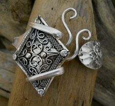 Antique fork bracelet made with a recycled metal pendant