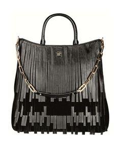 As franjas desta bolsa da Carolina Herrera nada têm a ver com tendências.  As tiras ec66d21f37