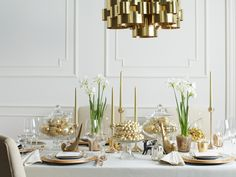 The recipe for an elegant table: A mix of simple glass and muted metals, plus delicate paperwhites in metallic pots.