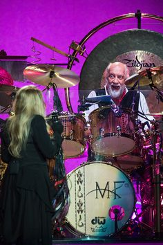 """Description of . DENVER, CO - APRIL 1: Mick Fleetwood (R) and Stevie Nicks (L) perform with Fleetwood Mac during the band's """"On With The Show"""" tour at the Pepsi Center April 1, 2015, in Denver, Colorado. (Photo by Daniel Petty/The Denver Post)"""