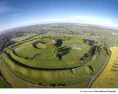 https://flic.kr/p/szcjcm | Old Sarum Castle | Old Sarum Castle Salisbury Wiltshire.  Just after sunrise - The Iron Age hill fort was where the first cathedral once stood and the Romans, Normans and Saxons have all left their mark.   All my images are © all rights reserved and are not to be used without my permission.