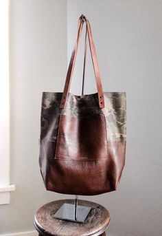 Two-tone camouflage Leather Tote - Beautiful, two tone leather tote bag. A perfect match with camouflage and brown leather, this bag will always be in style! A large exterior pocket is great for keeping keys and phone easy-to-reach. This bag has plenty of room for all your every day essentials. (Also available in Camo + Black!) #leathertote #leathercamouflage #madeinusa #makersmarket